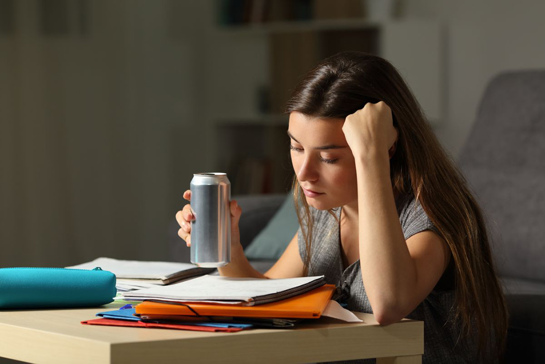 Student,Preparing,Exam,Memorizing,Notes,Holding,And,Energy,Drink,In